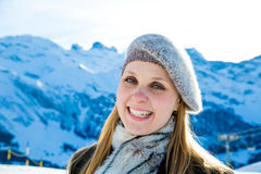 Pretty blonde girl smiling in the Alps.  Royalty Free Stock Photos