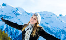 Pretty blonde girl smiling in the Alps.  Stock Photos