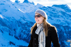 Pretty blonde girl smiling in the Alps.  Royalty Free Stock Image