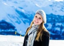 Pretty blonde girl smiling in the Alps.  Stock Photo