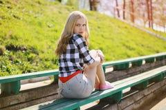Pretty blonde girl in summer Stock Photos