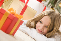 Pretty Blonde Hair Girl Looking At Small Red Gift Royalty Free Stock Photo