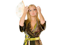 Pretty blonde with a hand fan Stock Photo