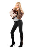 Pretty blonde with a handbag. Isolated Stock Photography