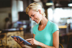Pretty blonde having a coffee using tablet pc Stock Photo