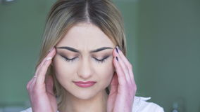 Pretty blonde having a headache in 4K stock footage