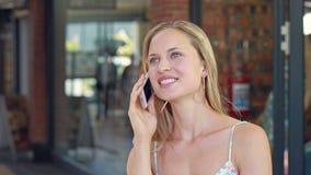 Pretty blonde having phone call stock video