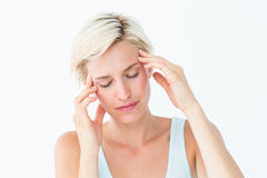 Pretty blonde with headache touching her temples Stock Photo
