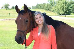 Pretty Blonde High School Senior Girl Outdoor with Horse Stock Photo