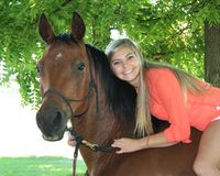 Pretty Blonde High School Senior Girl Outdoor with Horse. Pretty, long blonde hair, blue eyes, High School Senior girl outdoor equine portrait, riding bareback Stock Photos