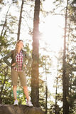 Pretty blonde hiker standing on stone Royalty Free Stock Image