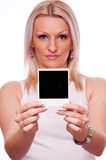 Woman holding blank instant photo frame Stock Photos