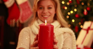Pretty blonde holding candle at christmas stock video