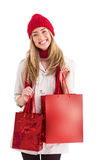 Pretty blonde holding shopping bags Royalty Free Stock Photos