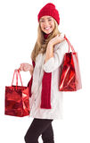 Pretty blonde holding shopping bags Stock Photography