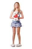 Pretty blonde holding teddy bear Royalty Free Stock Photography