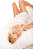 Pretty blonde hugging her pillow in the morning Royalty Free Stock Photo
