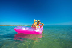 Pretty blonde on inflatable raft Royalty Free Stock Photo