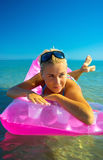 Pretty blonde on inflatable raft Stock Photos