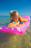 Pretty blonde on inflatable raft Stock Images