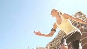 Pretty blonde jogging stock video