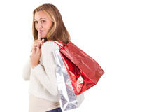 Pretty blonde keeping a secret holding bags Stock Photos
