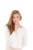 Pretty blonde keeping a secret Royalty Free Stock Image