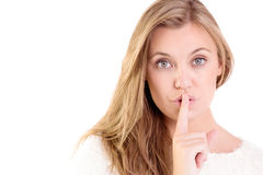 Pretty blonde keeping a secret Royalty Free Stock Photography