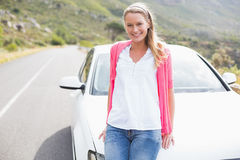 Pretty blonde leaning on the bonnet Stock Images