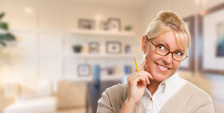 Pretty Blonde Librarian, Student or Businesswoman with Pencil in Office Royalty Free Stock Image