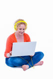Pretty blonde listening music with her laptop Royalty Free Stock Photo