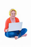 Pretty blonde listening music with her laptop Royalty Free Stock Photos