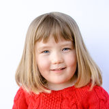 Pretty blonde little girl. Portrait of a smiling pretty blond girl with blue eyes isolated against a white background Royalty Free Stock Photography
