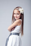 Pretty blonde little girl in white dress Royalty Free Stock Image