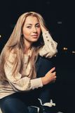 Pretty blonde looking at camera Royalty Free Stock Photography