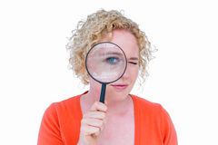 Pretty blonde looking at magnifying glass Royalty Free Stock Photography