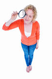 Pretty blonde looking at magnifying glass Stock Photos