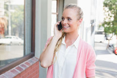 Pretty blonde making a call Stock Image