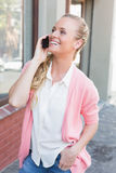 Pretty blonde making a call Stock Images