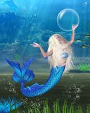 Pretty Blonde Mermaid With Underwater Background Royalty Free Stock Photo