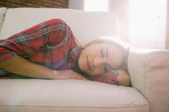 Pretty blonde napping on couch Stock Images
