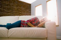 Pretty blonde napping on couch Royalty Free Stock Photo