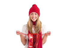 Pretty blonde opening gift bag Royalty Free Stock Photos