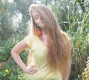 Pretty blonde outdoors. Colorized image Stock Photos
