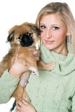 Pretty blonde with a pekinese Stock Images