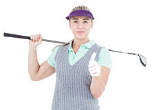 Pretty blonde playing golf and showing a thumbs up. On white background Royalty Free Stock Image