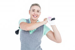 Pretty blonde playing golf Stock Image