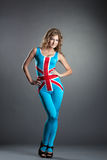 Pretty blonde posing in costume with British flag Stock Photo