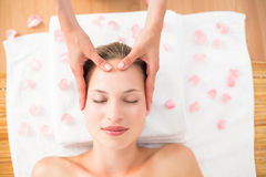 Pretty blonde receiving head massage Royalty Free Stock Images