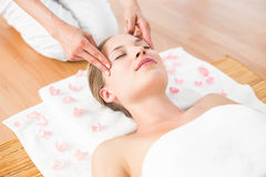 pretty blonde receiving head massage Stock Image